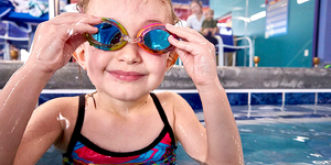 Smiling Child in Goggles